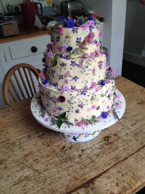 A wonderful cake made with edible flowers from fletching glasshouses